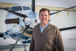 StraightLine Private Air Founder Tom Filippini in front of Turboprop